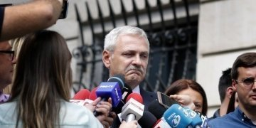 epa06739035 Liviu Dragnea (C) the president of the Romanian Parliament's Deputy Chamber and the leader of the main ruling party PSD (Social Democracy Party) speaks to journalists as he leaves the High Court of Cassation and Justice of Romania (ICCJ) headquarters (right, in the background ), after the last hearing, in Bucharest, Romania, 15 May 2018. DNA (National Anti-graft Directorate) prosecutors have demanded seven and a half years in prison for Dragnea in the file called 'DGASPC', in which the President of Chamber of Deputies, Liviu Dragnea, was accused of instigating to abuse of public function and of incitement to intellectual forgery. The verdict for this case was postponed to 29 May. EPA/ROBERT GHEMENT